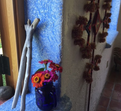 Window Sill Vibrant Blue Wood Piece and Wall Hanging Photo by Alice Walker