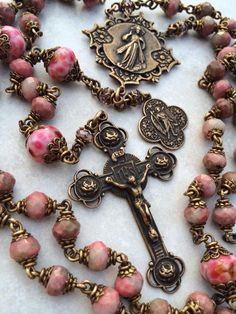 close up of a rosary with Mother Mary on it