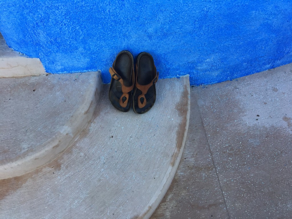 Photo of Alice Walker Sandals on stairs by blue wall