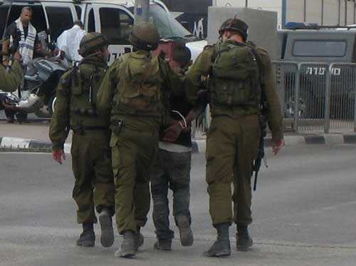 _Palestine-Israeli-soldiers-Abusing-child-and-praying-at-the-same-time-posted-2021-Alice-Walkers-Garden