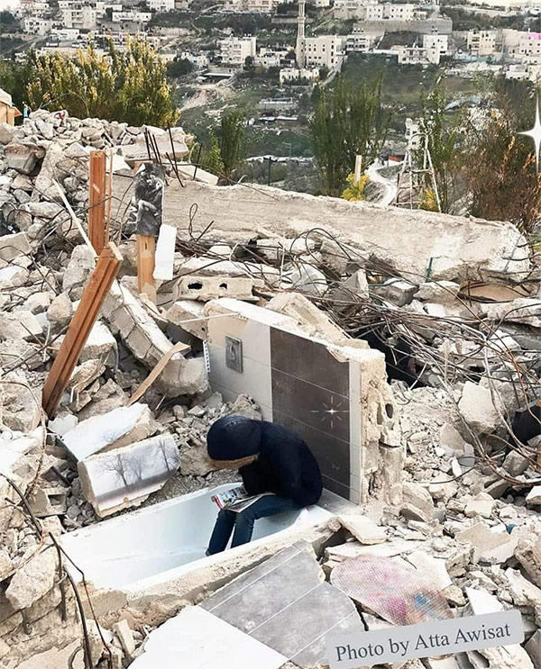 Palestinian Girl Sophia Abdo studying in the rubble that was once her home