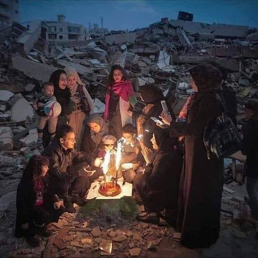 Family celebrating a birthday surrounded by homes destroyed and devastation Gaza 2021-05