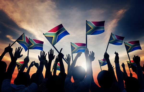 South African Flags Waving Crowd People South African Flags Waving Crowd People Silhouettes Sunset Clouds AliceWalkersGarden 20190522 Blog Post Insult to South Africans